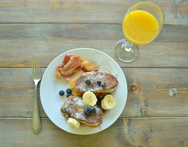 Nutella and Banana Stuffed French Toast with Orange Juice and Bacon