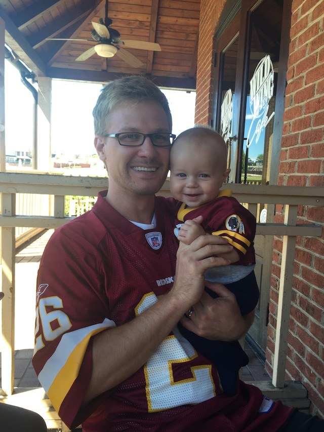 Seth and Remy cheering on the Redskins