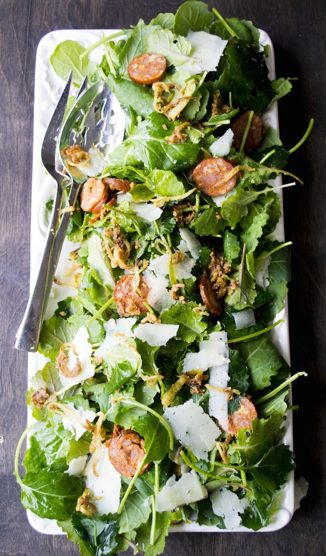 Baby Kale Salad with Spanish Chorizo, Manchego Cheese, Crispy Leeks and a Mustard Shallot Vinaigrette
