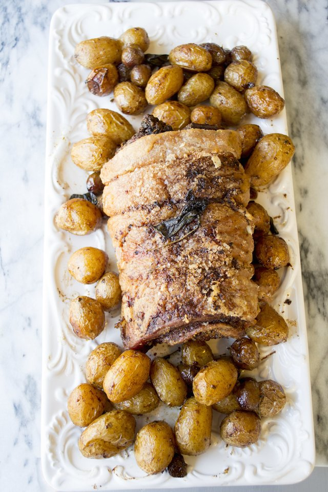 Kumquat Stuffed Porchetta with Crispy Sage Potatoes